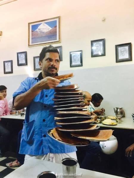 That's how dosa is served. Can you count the plates?