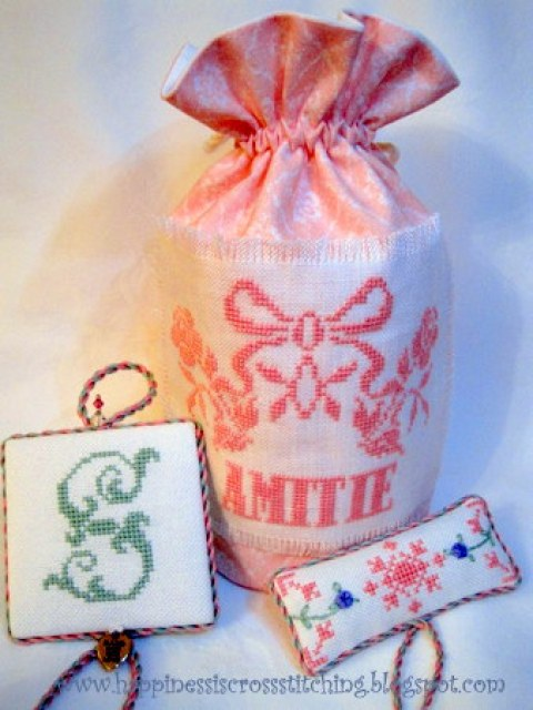 Pink cross stitched bag with matching pinkeep and pillow. The pinkeep  has the letter S stitched in a soft green colour which looks pretty against the pink lettering on the bag.