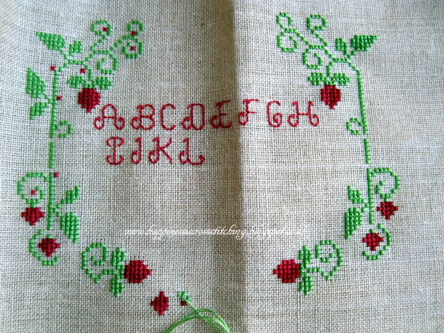Free Strawberry Cross Stitch Pattern featuring a pretty design of strawberries on a vine with an alphabet in the middle.