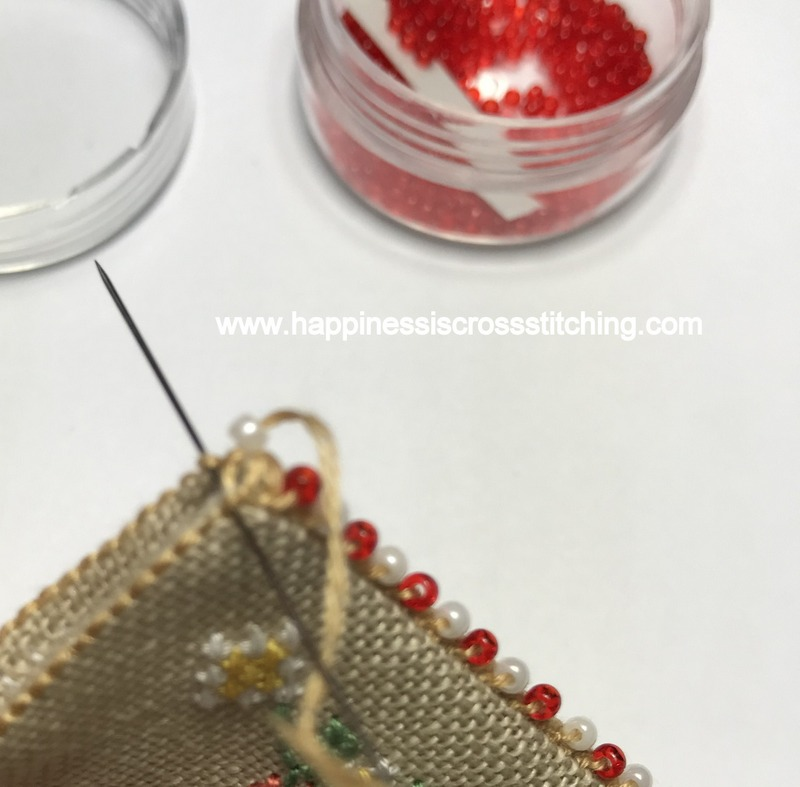 Stitching the corner of a beaded scissor fob