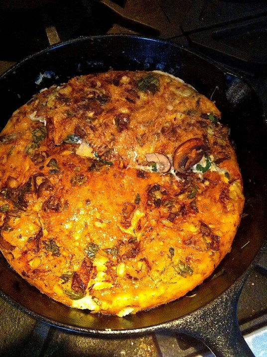 Mushroom & Spinach Frittata in pan, flipped
