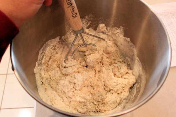 mixing ingredients with dough whisk