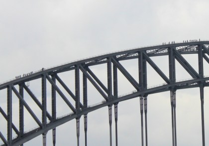 closeup showing climbers on the bridge