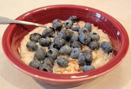 muesli topped with blueberries and honey