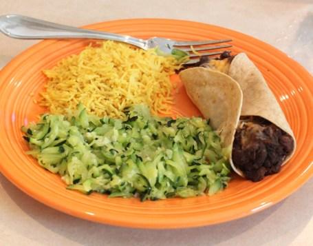 zucchini saute with black bean burrito and yellow rice