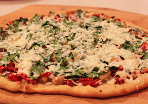 pizza with fresh greens