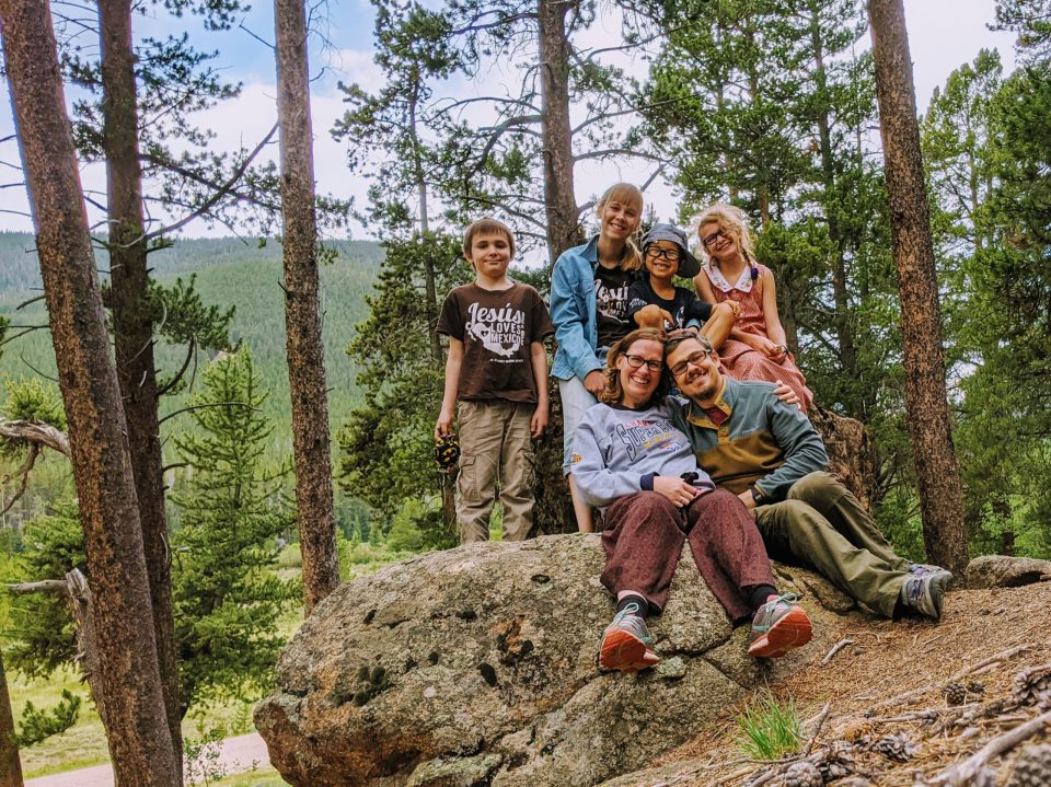 Jason and Jessica Wilde, members of the Happy Are You Poor Team, shown with their children
