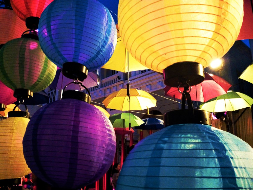 A colourful lantern and umbrella display at the street festival
