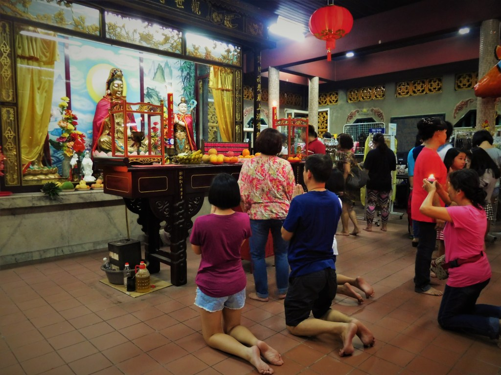 Worshippers praying at the Snake Temple