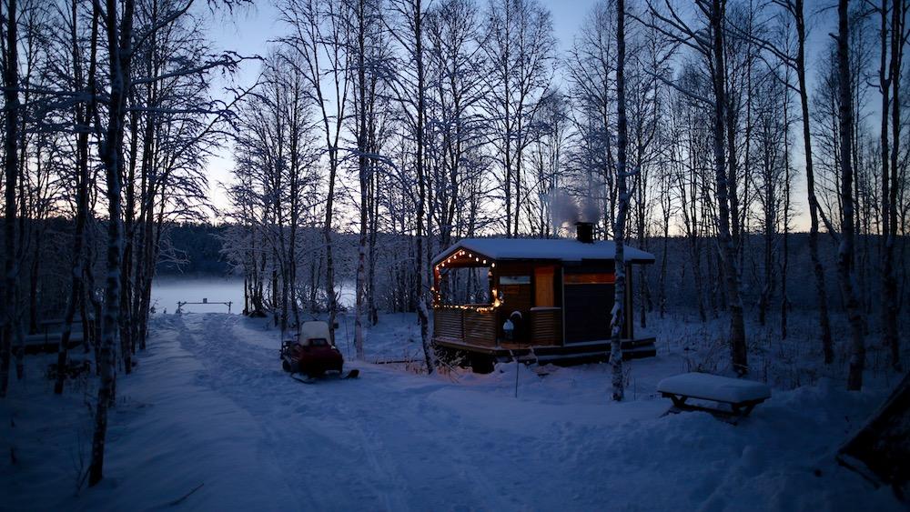 Happy-Fox-Arctic-Extreme-Ice-Swimming-and-Sauna-river-shore-p