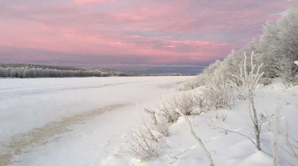 Happy-Fox-Trip-Along-the-Ounasjoki-River-on-Snowmobile-pulled-Sled-red-sky-and-Ounasjoki-River