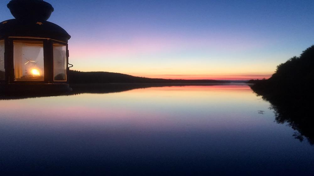 Happy-Fox-Floating-sauna-and-swimming-sunset