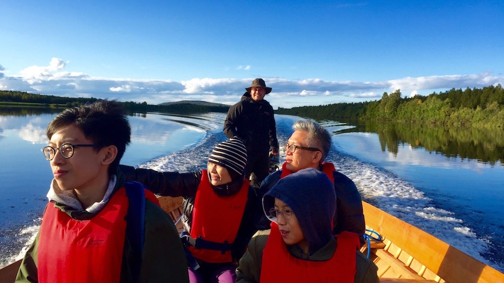 Happy-Fox-Arctic-Boat-Trip-to-the-Ounasjoki-river-long-golden-fox-riverboat