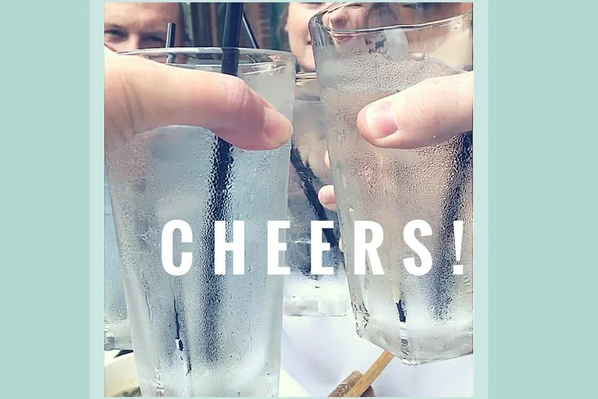 """Toasting glasses with text 'cheers"""""""