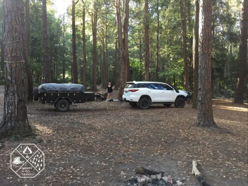 Black Series Alpha Camper trailer being towed by Toyota Fortuner - Pines Camping Watagans National Park