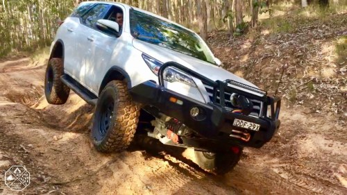 Toyota Fortuner CPT 80 road wheel off ground in big rut at entrance