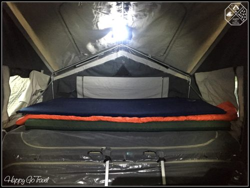 Camper trailer setup inside - beds and poles