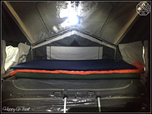 Camper trailer setup inside - beds and poles