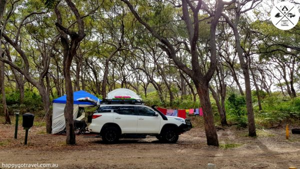 Toyota Fortuner parked in front of Black Series camper trailer setup at Fraser Island cathedrals | cost to go to fraser island