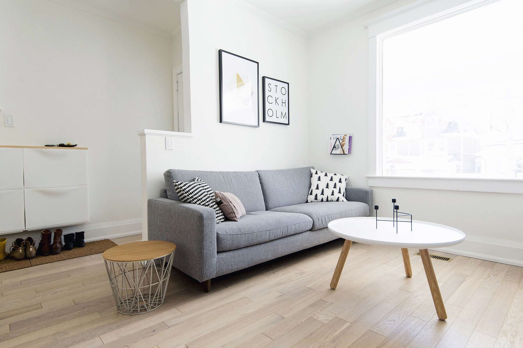 white and grey living room rocker glider cushions furniture house tour happy lucky scandinavian monochrome