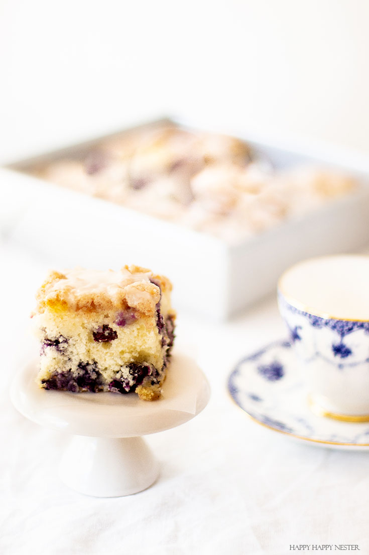 Need a yummy cake recipe? This dessert is The Best Blueberry Buckle Cake Recipe and is sure the perfect side to a cup of coffee or tea. Serve it as a dessert or as a morning blueberry coffee cake. This easy recipe makes an impressive cake with the crumble and delicious icing. #cake #coffeecake #blueberrydessserts #blueberries #desserts #pastry