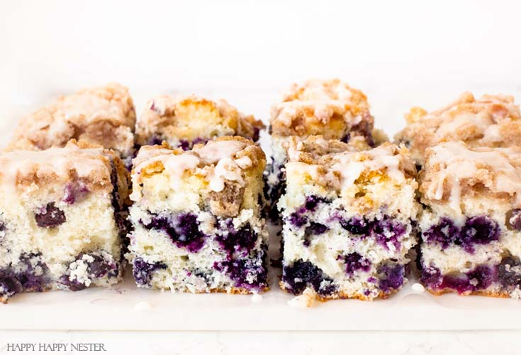Make this great cake! This dessert is The Best Blueberry Buckle Cake Recipe and is sure the perfect side to a cup of coffee or tea. Serve it as a dessert or as a morning blueberry coffee cake. This easy recipe makes an impressive cake with the crumble and delicious icing. #cake #coffeecake #blueberrydessserts #blueberries #desserts #pastry