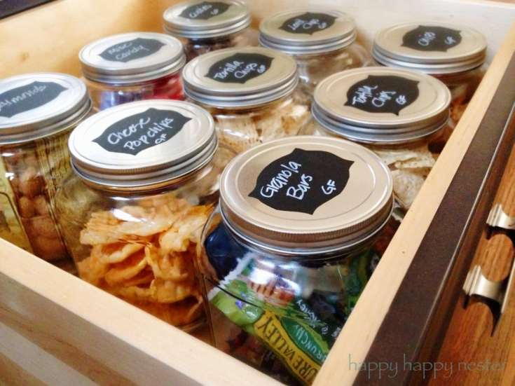 9 Tips For Kitchen Organization made easy. Follow these tried and true steps, your kitchen will be thoroughly organized. A well-organized kitchen is great. Place your snacks in big glass jars along with labels and your family will thanks you! #organizing