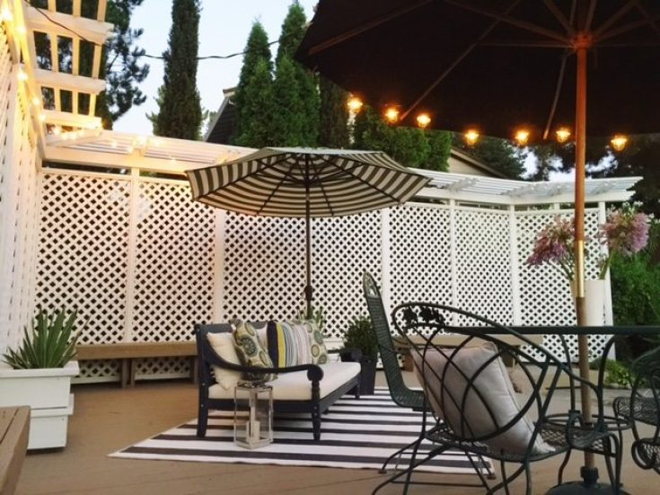Outdoor lighting is essential for a beautiful patio. Learn Learn How to Create a Cozy Outdoor Living Space in 9 easy tips. This DIY to summer decorating is essential. #summerdecor #outdoorlivingspaces #entertaining