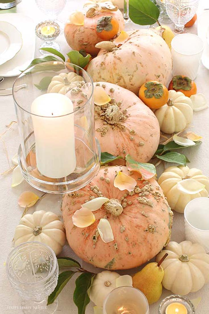 a table with pink and cream pumpkins