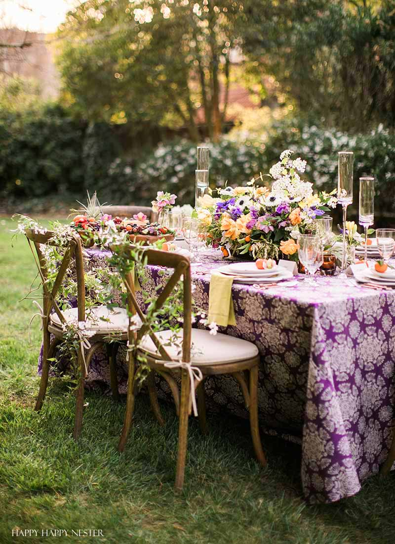 Take your spring table setting outdoors and add some gorgeous flower centerpieces to create a memorable setting. With my step by step way to build your table, you can have a lovely outdoor table ready for entertaining. #diy #tabledecor #tablescape #springdecor #springtable #springtablesetting #flowercenterpieces