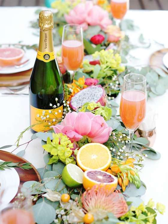 Citrus with flowers make the best wedding table