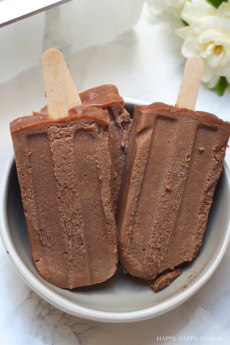 three homemade popsicles in a bowl