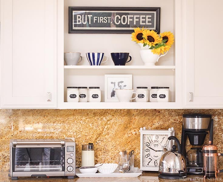 a kitchen countertop and white shelves with coffee decor