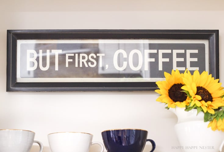 A farmhouse sign about coffee hanging on a white wall
