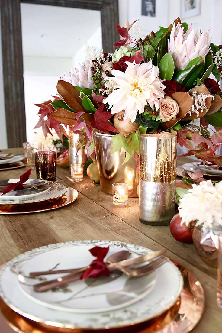 gold and blush fall decor on a fall table.