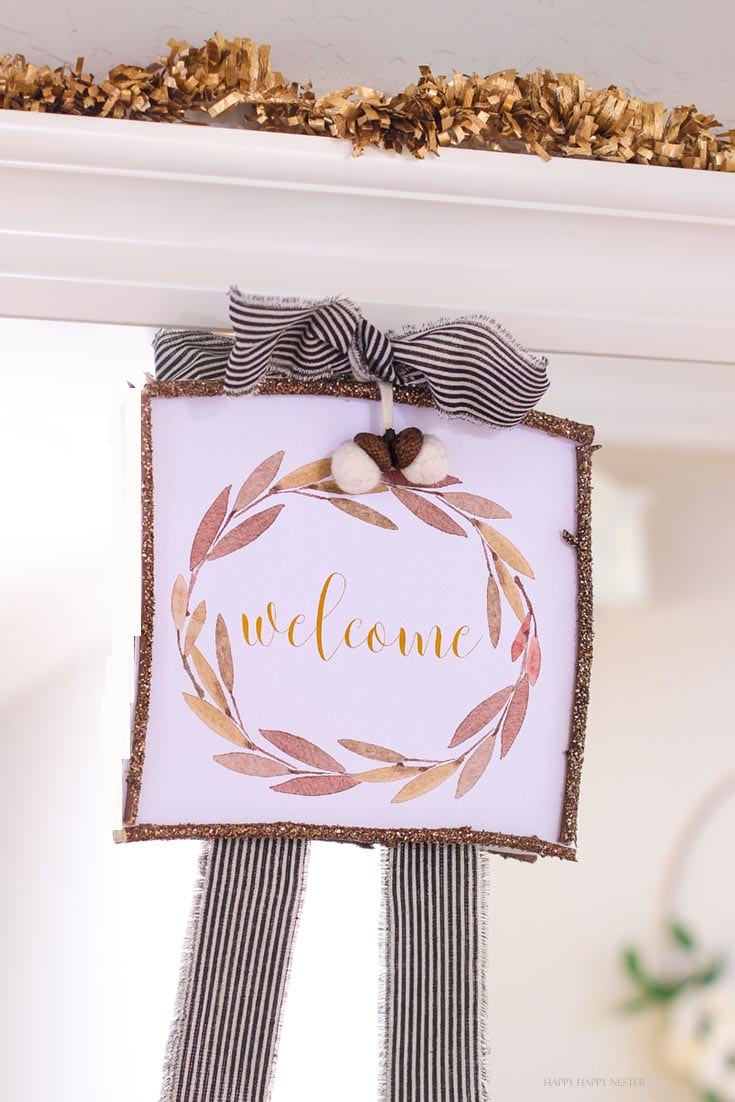 A rustic farmhouse style fall craft hanging on a mirror
