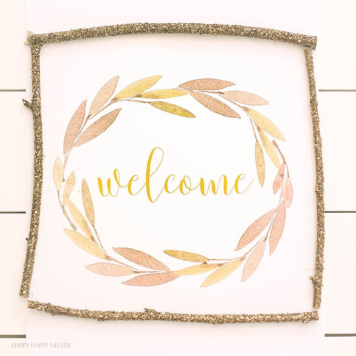Farmhouse style welcome sign on white table