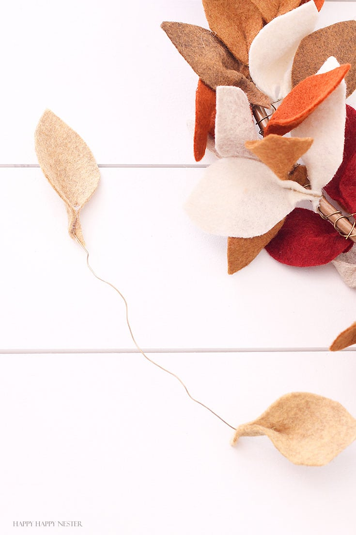 tan leaves attached to a wire