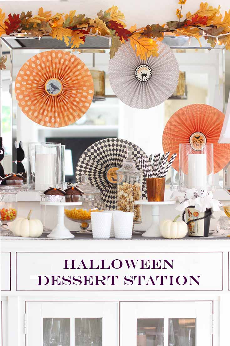 Picture of a Halloween dessert station with a graphic. This is a pin image