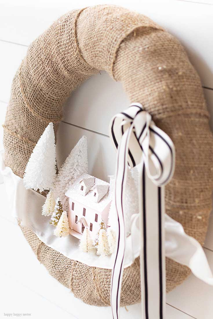 Make this DIY Christmas Village Wreath with homemade putz houses. Add some bottle brush trees, ribbon and you have a personal holiday wreath. | Crafts | Wreaths | Holiday Wreaths | Putz Houses | DIY Wreaths | DIY | Wreath Making | Cute Wreaths | Mini Village Houses | Homemade Wreaths | Martha Stewarts Village Wreath |