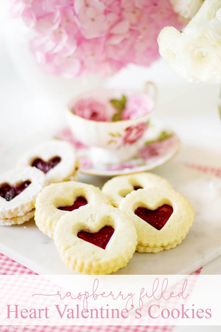 This Raspberry Filled Valentine's Heart Cookie Recipe is the perfect dessert for a dinner or a party. Give them away as a Valentine's Day gift for a friend. Sprinkle them with powdered sugar for an extra-amazing sugar cookie. Cookie | Baking | Valentine's Day Treats | Cookie Recipe | Raspberry Filled Cookies