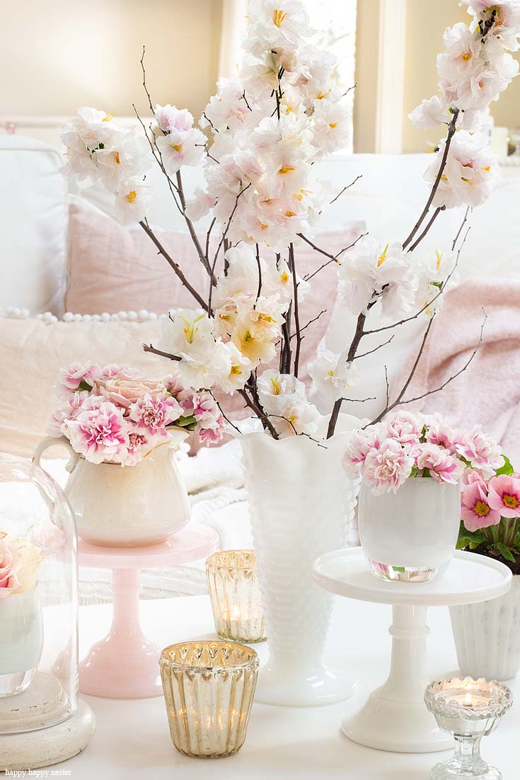 Find out how to introduce a few easy elements when creating a new look. The best way to say goodbye to winter is a Pretty Pink Spring Home Tour. I love how happy the color pink is, and it is so pretty in our living room, entry and dining room. Adding fresh flowers brightens a home and welcomes family and friends with a warm embrace. #decorating #springdecor #springtour #pinkdecor #hometour