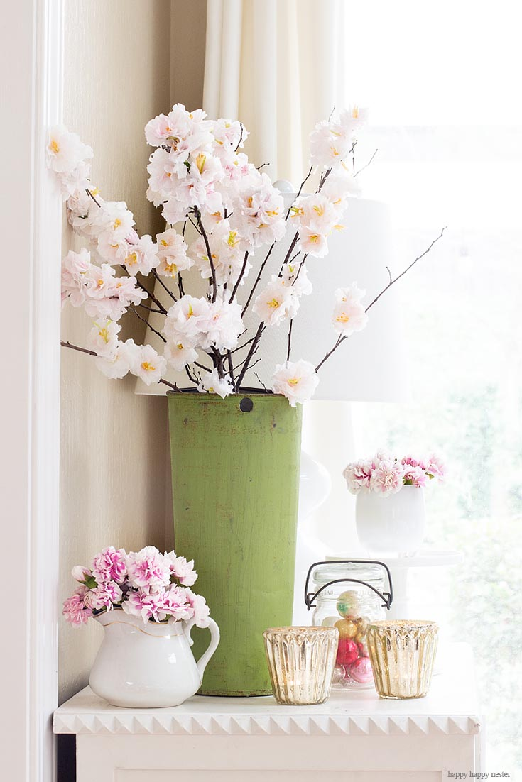 Find some inspiration with flowers for this spring. The best way to say goodbye to winter is a Pretty Pink Spring Home Tour. I love how happy the color pink is, and it is so pretty in our living room, entry and dining room. Adding fresh flowers brightens a home and welcomes family and friends with a warm embrace. #decorating #springdecor #springtour #pinkdecor #hometour