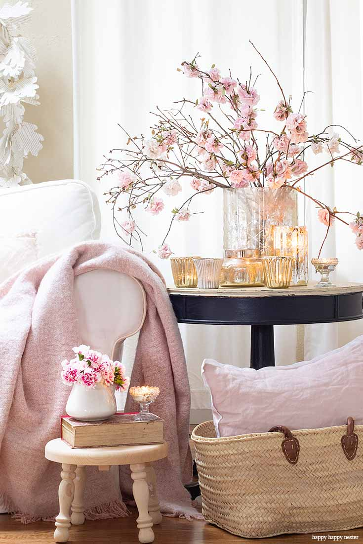 Add candles and paper flowers to create a new spring home. The best way to say goodbye to winter is a Pretty Pink Spring Home Tour. I love how happy the color pink is, and it is so pretty in our living room, entry and dining room. Adding fresh flowers brightens a home and welcomes family and friends with a warm embrace. #decorating #springdecor #springtour #pinkdecor #hometour