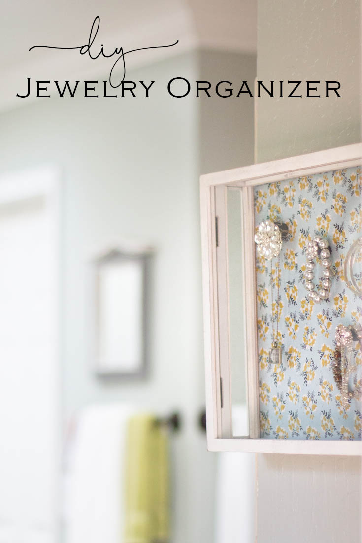 This Magnetic Hanging Jewelry Organizer DIY is the perfect way to display your jewelry and organize it as well. It is a magnetic board that you can place either fabric or paper on it and then make moveable magnetics that holds your jewelry in place. Crafts | Jewelry Holder | Organizing | Jewelry | Magnetic Board