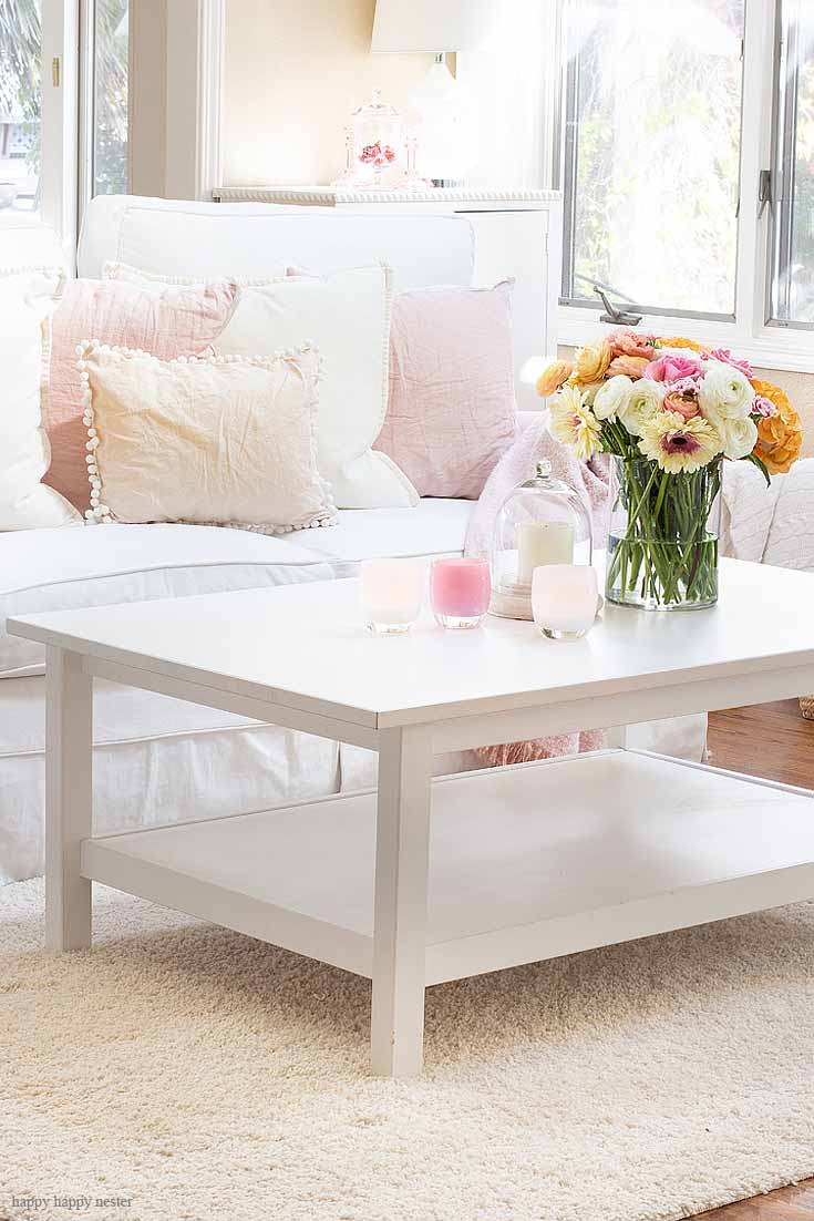 Get a new spring style with this fun home tour. The best way to say goodbye to winter is a Pretty Pink Spring Home Tour. I love how happy the color pink is, and it is so pretty in our living room, entry and dining room. Adding fresh flowers brightens a home and welcomes family and friends with a warm embrace. #decorating #springdecor #springtour #pinkdecor #hometour