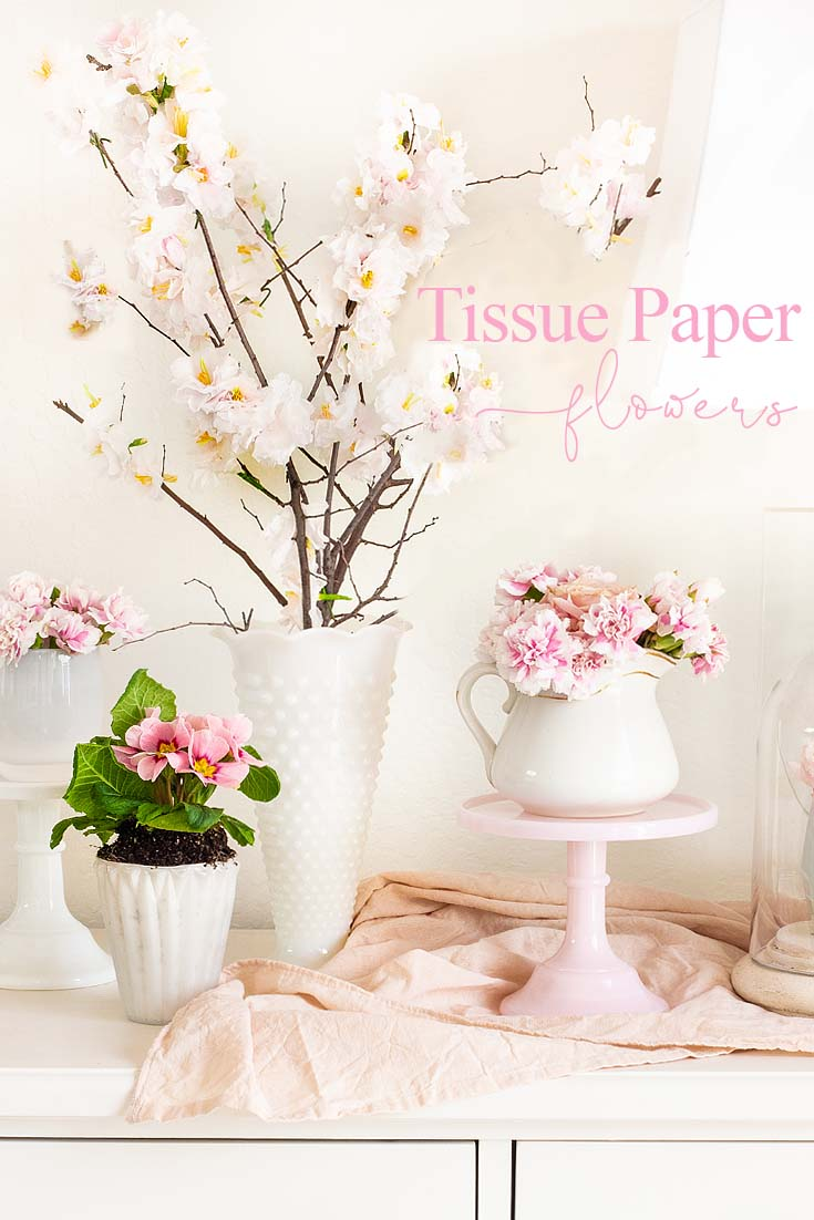 This Tissue Paper Flowers Tutorial creates realistic cherry blossoms. The flowers attach to a real tree branch, and they look amazing. This project has full instructions and you can make them from home. These paper flowers are great for home as well as for weddings. #paperflowers #crafts #papercherryblossoms #weddings