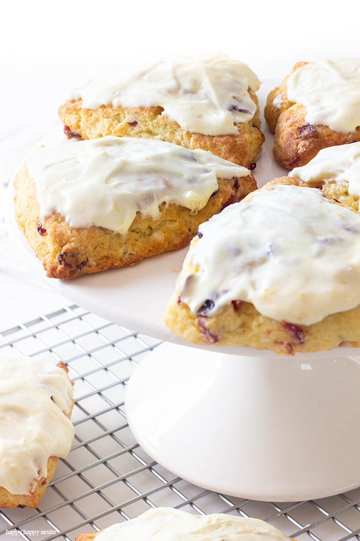 Do you have the Magnolia Table Cookbook? Well, I was inspired by Joanna's recipe and this Fresh Orange Scone Recipe is the perfect blend of orange and cranberries and a creamy, moist dough. Cold shredded butter and minimal handling of the dough is the key to a fluffy English scone. Orange zest and juice is a delicious pair to cranberries. #baking #scones #joannagaines #favoriterecipes #englishscones