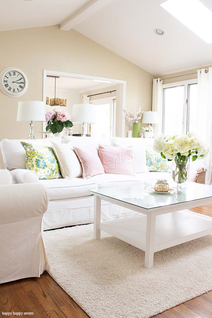 Learn how I add fresh pink hydrangeas with spring pillows to create a spring style. The best way to say goodbye to winter is a Pretty Pink Spring Home Tour. I love how happy the color pink is, and it is so pretty in our living room, entry and dining room. Adding fresh flowers brightens a home and welcomes family and friends with a warm embrace. #decorating #springdecor #springtour #pinkdecor #hometour