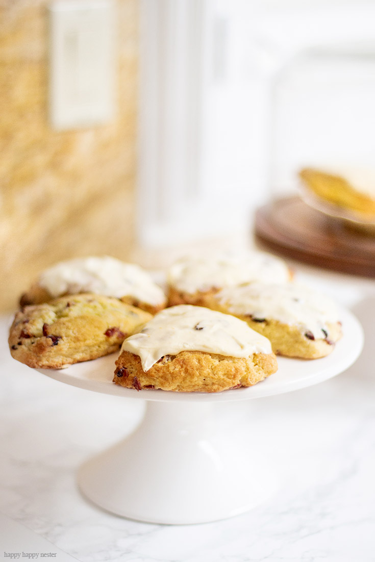 Inspired by Joanna Gaines Magnolia Table cookbook, these fresh orange scones are delicious and refreshing. The sweet icing adds just the perfect amount of richness to this yummy dessert. #scones #englishscones #recipes #joanngaines